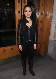T.V. wears a little leather motorcycle jacket for this edgy look.