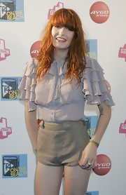 Florence was all ruffles in a lilac blouse and mini shorts.