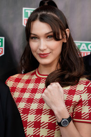Bella Hadid accessorized with a diamond-embellished watch by Tag Heuer.