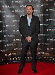 Leonardo DiCaprio looked dapper as ever in a deep charcoal gray two-piece suit.