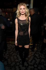 AnnaLynne McCord caught stares in a partially sheer mini dress at the TAO, Beauty & Essex, Avenue and Luchini LA grand opening.