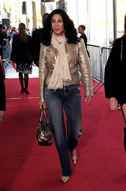 Cher complemented her gold jacket with a white scarf for a chicer finish at the TCM Classic Film Festival.
