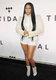 Nicki Minaj was OTT, as always, in a white jacket that was part fur, part snakeskin, and part appliqued leather during Tidal X: 1015.