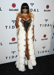 Remy Ma caught eyes in a Jennifer Le fur coat layered over a corset at the TIDAL X benefit concert.