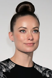 Olivia Wilde showed off her high fashion side with a sleek top knot.