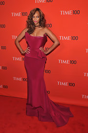 Tyra Banks posed dramatically in this equally dramatic Merlot gown at the Time 100 Gala.