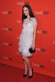 Georgina Chapman paired her feathery white frock with classic black patent leather pumps.