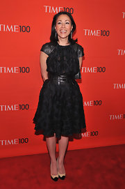 Ann Curry's LBD at the Time 100 Gala had some creative uice with its leather mesh sleeves.