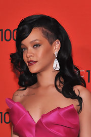 Rihanna paired her hot pink dress with a rich cranberry shade of lipstick.