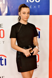 Emma Chamberlain accessorized with a chic black and gold box clutch by Louis Vuitton at the Time 100 Next event.
