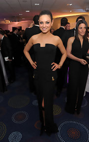 Mila Kunis was a dark seductress at the White House Correspondents' dinner cocktail party in a strapless Versace gown. The tanned actress looked stunning in the structured gown with a high slit and decorative flap pockets. This beauty knows how to make a black dress memorable!