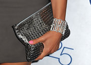 Nadine's gunmetal clutch brought some edge to her simple gray dress.