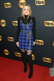 Dakota Fanning looked adorably mod in an Adam Selman gingham knit dress layered over a black turtleneck at the TNT and TBS Lodge during Sundance.