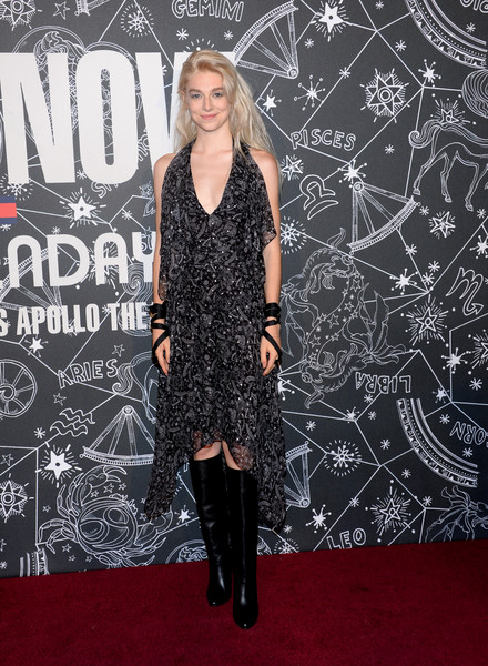 Hunter Schafer went for edgy styling with a pair of black knee-high boots.