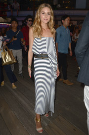 Olivia Palermo looked effortlessly chic, as always, in a striped spaghetti-strap dress by Tommy Hilfiger while attending the label's fashion show.