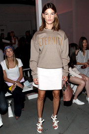 Hanneli Mustaparta attended the 3.1 Phillip Lim fashion show wearing a loose tan Calvin Klein sweatshirt.