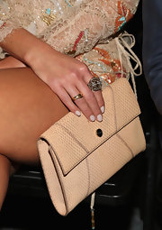 Jordana Brewster's envelope clutch was a trendy and textured finishing touch to her outfit.