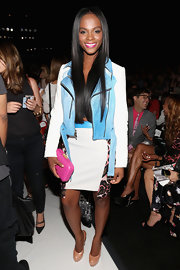 Tika Sumpter wore a busy-looking blue and white skirt suit with leopard-print paneling to the Rebecca Minkoff fashion show.