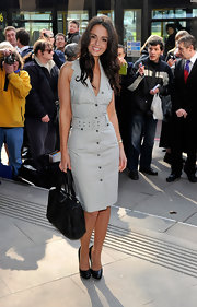 Jennifer weras a cutton-down halter day dress with a utility edge to the TRIC Awards.