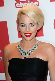 Lydia Bright looked radiant in a diamond and emerald chandelier necklace.
