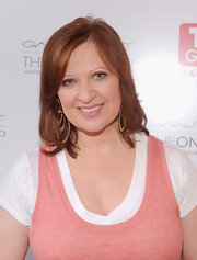 Caroline Manzo attended the TV Guide Magazine/Andy Cohen book signing party with minimally-styled straight hair.