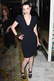 Katie paired her strappy sandals with a black cocktail dress and a sleek bun.