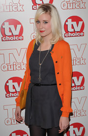Lily Loveless paired her grey day dress with a classic cross necklace.