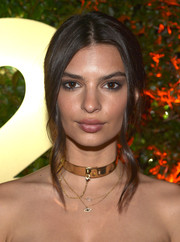 Emily Ratajkowski looked elegant wearing this loose center-parted updo at the E3 kickoff party.