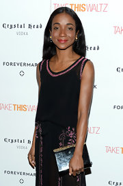 Genevieve Jones brought a stunning black mirrored frame clutch with a gold beaded handle to the screening of 'Take This Waltz.'