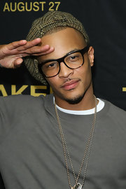 T.I. showed off his square sunglasses while hitting the premiere of 'Takers' in New York.