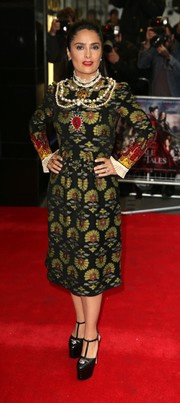 Salma Hayek looked opulent in a Gucci print dress with pearl embellishments at the UK premiere of 'Tale of Tales.'
