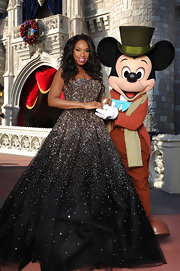 Jennifer Hudson followed in Olivia Wilde's Golden Globe footseps wearing a strapless black and bronze princess gown for her performance on the Disney Christmas special.