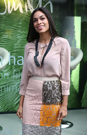 Rosario Dawson's black beaded necklace added a dash of darkness to her light and lacy look.