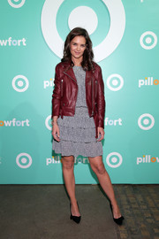 Katie Holmes toughened up her dress with a red leather biker jacket by Saint Laurent.