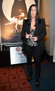 A pair of slouchy black knee-high boots added a touch of edginess to Cher's look during the AFI's Night at the Movies.