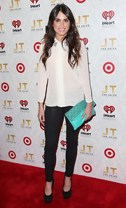 Nikki Reed showed off her casual red carpet look with these fitted leather pants.