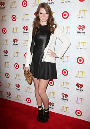 Claire Thomas paired a white blazer over her leather dress for a slightly toned-down red carpet look.