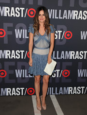 Rachel Bilson paired a floaty Christian Dior frock with a pristine white clutch.