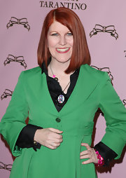 Actress Kate Flannery showed off her fiery red bob hair cut at a recent event. The color contrast between her hair and jacket was quite alarming.