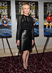 Kirsten Dunst was all about edgy elegance in a long-sleeve black mesh blouse by Louis Vuitton at the screening of 'Sleeping with Other People.'