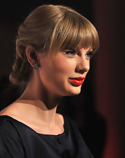 Taylor wore an intricately twisted updo with full fringe for the release of her CD at Target.