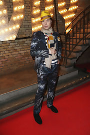 Rufus Wainwright paired a funky tie-dye suit with a bright yellow fedora for an extra colorful look.