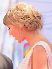 Taylor Swift wore her hair in a romantic twisted bun to the Teen Choice Awards in 2012.