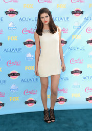 Alexandra looked mod-chic with a white shift dress with an embellished collar.