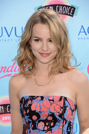 Bridgit's soft blonde waves kept her TCA look young and flirty on the blue carpet.