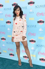 Kerry went for a totally fun and charming look with this blush pink mini dress with embroidered and charm details.
