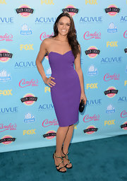 Michelle showed off her toned arms with a royal purple strapless pencil dress.