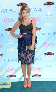 Ashley Benson showed a peek of skin with this bustier-style black crop top paired with a stunning embellished skirt.