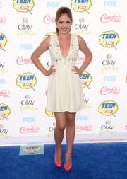 McKaley Miller flashed some cleavage at the Teen Choice Awards in an ASOS LWD with a daring neckline and an embellished bodice.