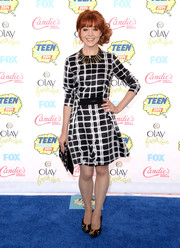 A pair of zipper-accented black pumps added a playful touch to Lindsey Stirling's look.